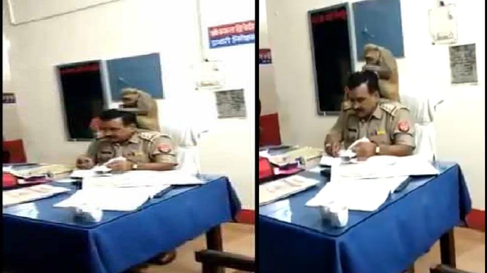 Viral Video:ಪೊಲೀಸ್ ಅಧಿಕಾರಿ ಭುಜದ ಮೇಲೆ ಕುಳಿತು ತಲೆ ಕ್ಲೀನ್ ಮಾಡಿದ ಕೋತಿ!